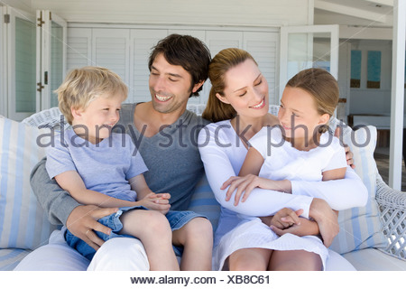 Family relaxing on sofa together Banque D'Images