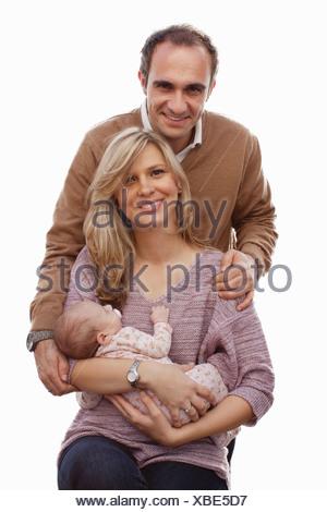 Couple avec bébé nouveau-né fille Banque D'Images