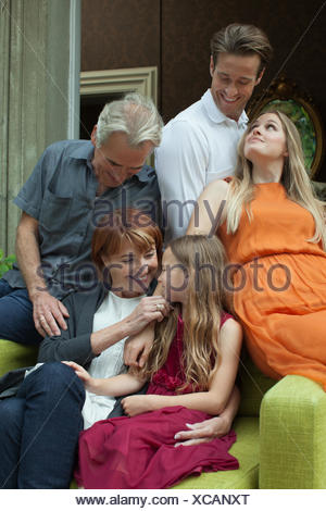 Portrait of smiling multi-generation family sitting on sofa Banque D'Images
