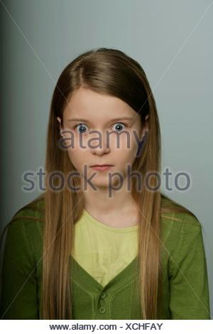 Peur girl looking at camera