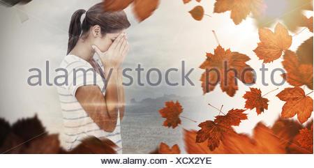 Composite image bouleversée woman covering face Banque D'Images
