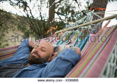 Serene woman relaxing in hammock Banque D'Images