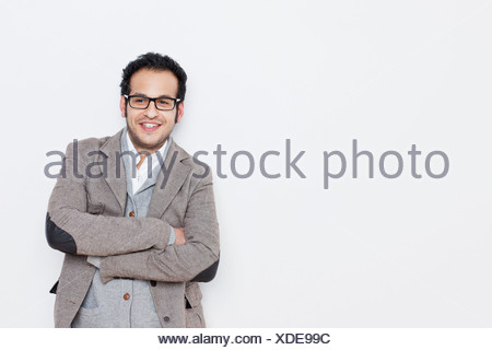 Businessman standing with arms folded Banque D'Images