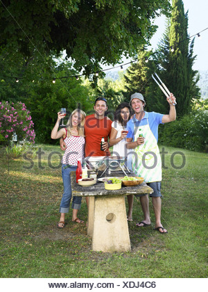 Friends celebrating at barbecue Banque D'Images