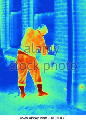Photographie thermique d'un cambrioleur par effraction dans une chambre Banque D'Images