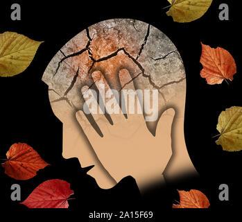 In autunno la tristezza e la depressione, giovane. Stilizzata testa maschio silhouette tenendo la sua testa.foto-montaggio a secco con massa rotto e foglie di autunno simbolo Foto Stock