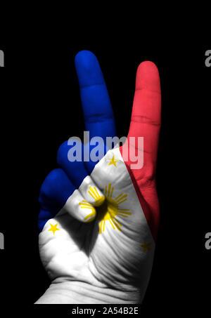 La pace mano segno di un filippino. Foto Stock
