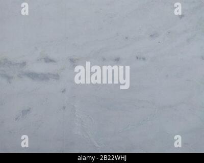 Moderno edificio grigio pietra calcarea di vernice texture di sfondo bianco di cucitura di luce home carta da parati. Torna piatta concreta della metropolitana tavolo in pietra piano concetto surreale granit Foto Stock