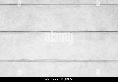 Vista frontale di una parete in pietra grigia intonacata. Sfondo astratto ad alta risoluzione full frame in bianco e nero.