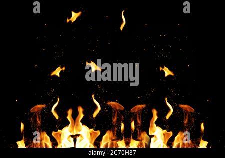 grande falò ardente con fiamme e scintille arancioni che volano in direzioni diverse su uno sfondo nero, full frame