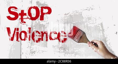 Fermare le parole di violenza sulla parete, pennello. Concetto di prevenzione degli abusi domestici