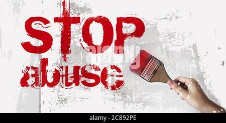 fermare l'abuso mano con pennello sulla parete bianca grunge