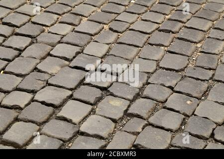 Sfondo astratto di vecchi cobblestone pavement close-up Foto Stock