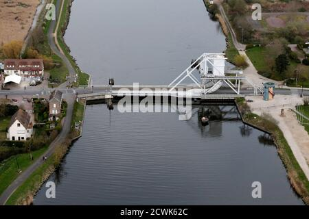 An aerial view shows the new Pegasus Bridge, a structure that replaced the World War II bridge in 1994, in Benouville in the Normandy region, March 29, 2014. Pegasus Bridge was captured by British forces on the night of 5-6 June 1944, an important strategic point as part of the Allied invasion during World War II. France prepares to commemorate the 70th anniversary of World War II D-Day beach landings to be celebrated June 6, 2014. Picture taken March 29, 2014.    REUTERS/Christian Hartmann (FRANCE  - Tags: CONFLICT CITYSCAPE ANNIVERSARY TRAVEL) Foto Stock