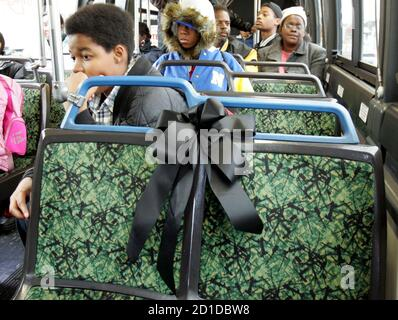 A black ribbon placed on the front seat of a Detroit city bus honors civil rights pioneer Rosa Parks as bus riders leave the seat empty in Detroit, Michigan, October 27, 2005. Buses in Detroit and [Alabama] are honoring Parks by reserving the first seat of their buses as a tribute to her legacy until her funeral next week. Parks, the black woman who refused to yield her seat to a white man in 1955, died on Monday in Detroit at the age of 92. Parks is known as the mother of the modern U.S. civil rights movement.
