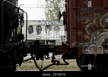 The portraits of Martin Luther King, Malcolm X, Robert Kennedy and Harriet Tubman (L-R), are seen on the wall of a grocery store in Vicksburg, Mississippi September 7, 2005. The State of Mississippi now begins the rebuilding process in the aftermath of Hurricane Katrina, which claimed more than 200 lives along its Gulf Coast. Picture taken September 7, 2005. REUTERS/Robert Galbraith  RG/CCK
