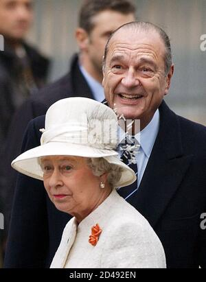 French President Jacques Chirac receives Queen Elizabeth II during an official ceremony with full military honours on the Champs Elysees in Paris, April 5, 2004. Queen Elizabeth II and her husband The Duke of Edinburgh start a three-day state visit to mark the centenary of the Entente Cordiale, the colonial-era promise of cross-channel friendship between Britain and France. REUTERS/Eric Feferberg/Pool  JES/WS