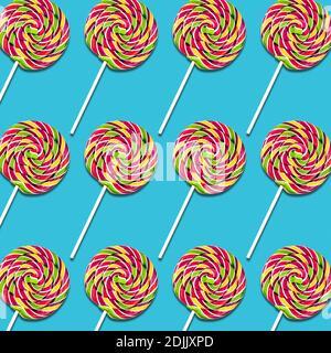Disposizione simmetrica dei lecca-lecca caramelle su sfondo turchese, colorato sweet food texture Foto Stock