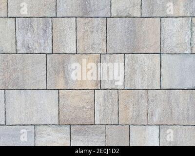 Struttura in pietra, pietra naturale, pietra a ponte e piastrelle di design. Vista dall'alto, colore grigio, sfondo e trama Foto Stock