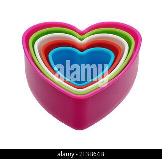 Set di tagliabasette per biscotti in plastica a forma di cuore colorato, tagliato Foto Stock