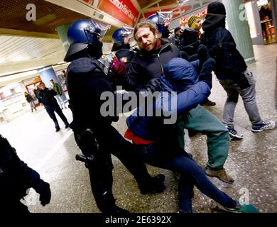 Police officers push anti Patriotic Europeans Against the Islamisation of the West (PEGIDA) protestors out of the underground train station, during demonstration by PEGIDA in Frankfurt February 2, 2015. The weekly PEGIDA demonstrations began last October as a local protest against the building of new shelters for refugees, and have been growing in size. Counter-marches have taken place across Germany, with far larger numbers.  REUTERS/Kai Pfaffenbach (GERMANY  - Tags: CIVIL UNREST POLITICS)