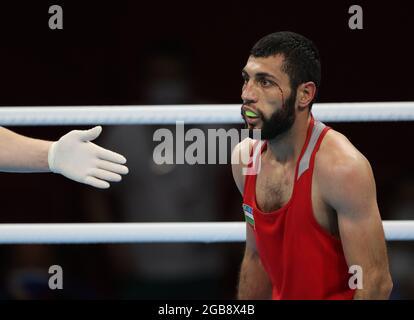 Tokyo 2020 Olimpiadi - Boxing - Men's Flyweight - Quarterfinal - Kokugikan Arena - Tokyo, Giappone - 3 agosto 2021 Shakhobidin Zoirov di Uzbekistan in azione REUTERS/Carl Recine