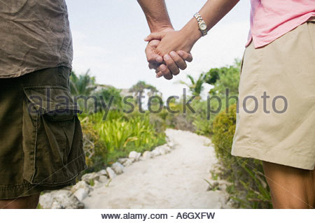 Giovane Holding Hands Foto Stock