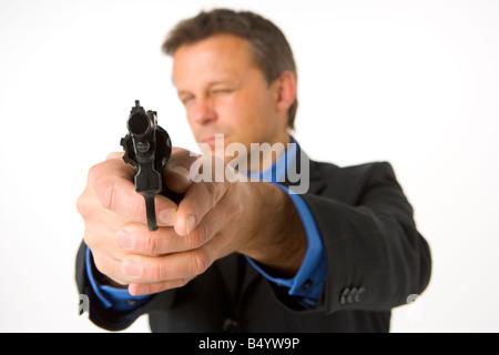 Imprenditore pistola di puntamento Foto Stock