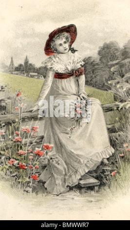 Donna in abiti estivi seduto su di una recinzione di legno Foto Stock