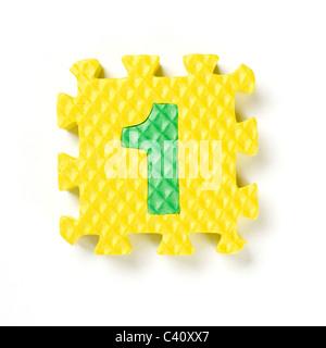 Pezzo di puzzle numero uno 1 Foto Stock