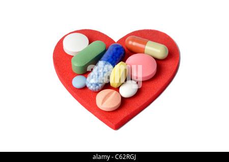Cuore e pillole Foto Stock