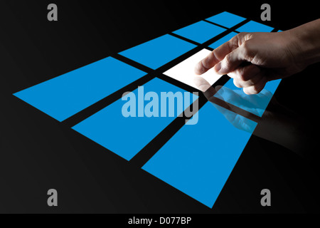 Dito toccando Blue Digital Touch Screen Foto Stock