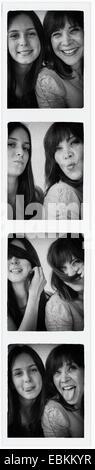 Foto con Photo Booth della ragazza adolescente (14-15) e sua mamma Foto Stock