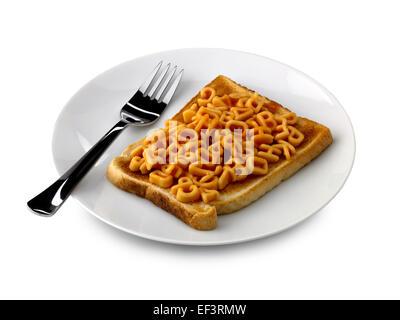Alfabeto spaghetti su pane tostato Foto Stock