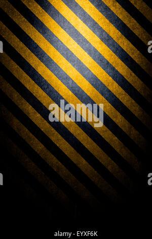 Pericolo di trama con sfondo nero e giallo linee angolate Foto Stock