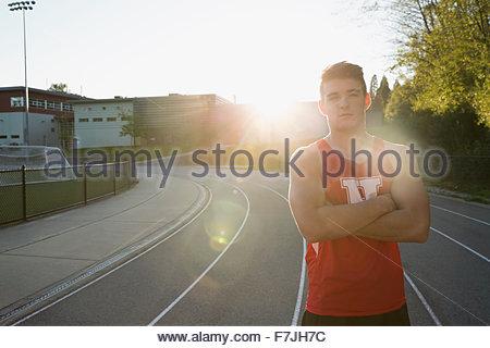 Ritratto fiducioso di alta scuola via e atleta di campo Foto Stock