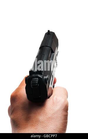Man mano che tiene una pistola Foto Stock
