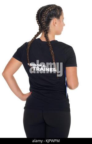 Femmina di Personal Trainer, con la schiena rivolta verso la telecamera, isolato Foto Stock