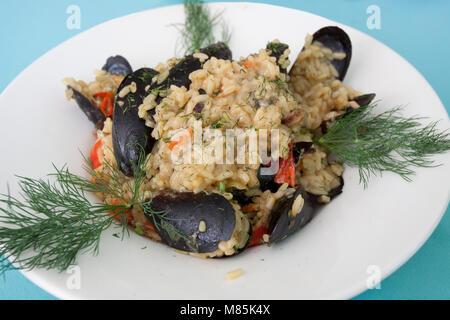 Pasto Risotto cozze Foto Stock