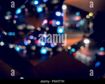 Blur immagine di Hong Kong vista notturna con cerchio bokeh di fondo Foto Stock