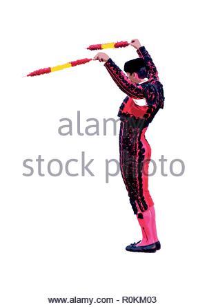 Azienda Banderillero banderillas decorata con la bandiera della Spagna i colori nelle sue mani. illustrazione vettoriale Foto Stock