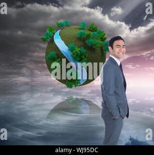 Immagine composita di imprenditore sorridente in piedi Foto Stock