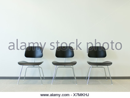 Tre sedie Foto Stock