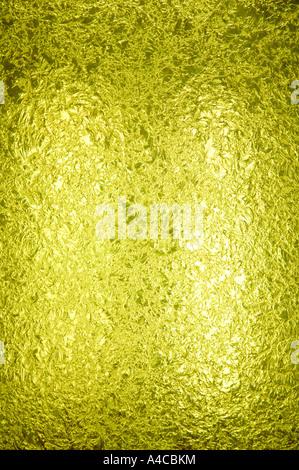 Un pannello retroilluminato splendidamente textured giallo vetro macchiato. lo spazio per la copia. La fotocamera Nikon D2x. Foto Stock