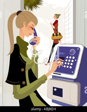 Close-up di una giovane donna che utilizza un telefono a pagamento