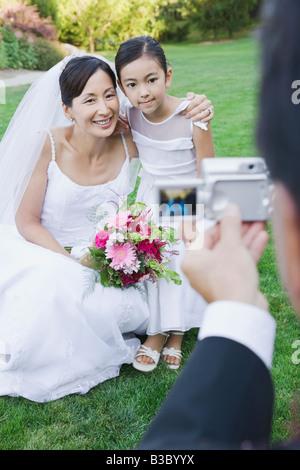 Bride asiatico e fiore ragazza avente fotografia scattata Foto Stock