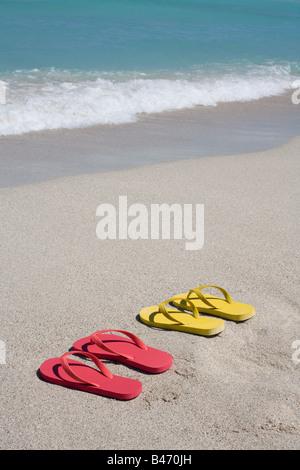 Il flip flop sulla spiaggia Foto Stock