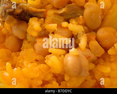 """""""Arroz al horno' (aka """"Arros al forn' o piatto di riso al forno). Piatto tipico della cucina valenciana. Spagna Foto Stock"""