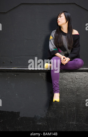 Elegante giovane donna Foto Stock