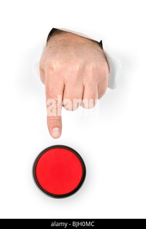 Una mano con il dito indice di poke estesa attraverso la presenza di frammenti di carta si prepara a spingere il Foto Stock